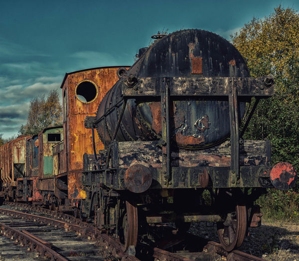 Abandoned Bad Condition Damaged Day Destruction Deterioration History Locomotive Metal No People Obsolete Old Old Ruin Old-fashioned Outdoors Rail Transportation Railroad Track Run-down Rusty Sky Steam Train The Past Train - Vehicle Transportation Weathered