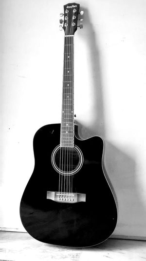 music creator. EyeEm Selects Blackandwhite Fine Art Photography Mobilephotography Fineart Lifestyles Contrast Creativity Fun Guitar Strings Blackandwhite PhonePhotography Guitar Musical Instrument Music Musical Instrument String Arts Culture And Entertainment Woodwind Instrument Musical Equipment Music Style  Classical Guitar Jazz Music Acoustic Guitar String Instrument