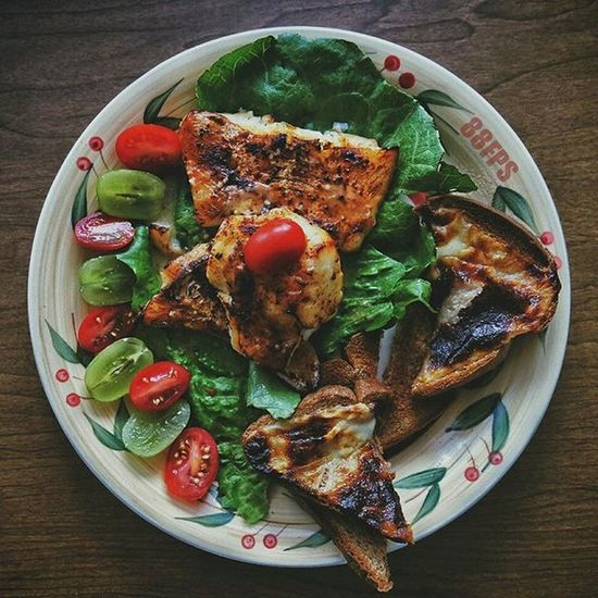 "So my mom asked me this morning, ""what would you like to eat."" And I said I'm in the mood for something a little different and weird. I said, ""I would like some cod fish, red tomatoes, and green grapes on a bed of lettuce with some toast with some slightly charred mozzarella cheese."" She laughed at me like I was crazy. she tells me 20 minutes later to come to the kitchen. And this was on the table Ilovemymom Breakfast"