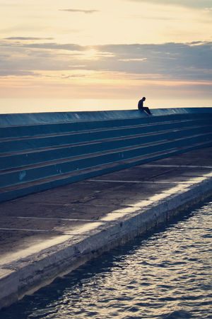 Lone figure taking in the scenery at Newcastle Ocean Baths, Australia Baths Nature Ocean One Person Outdoors Peaceful People Pool Scenics Sea Silhouette Sky Sunrise Tranquil Scene
