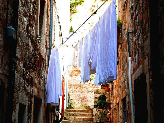 Hanging Clothesline Drying Laundry Textile Curtain Clothing Clothespin Building Exterior House Built Structure Residential Building Linen Window No People Coathanger Cloth Day Indoors