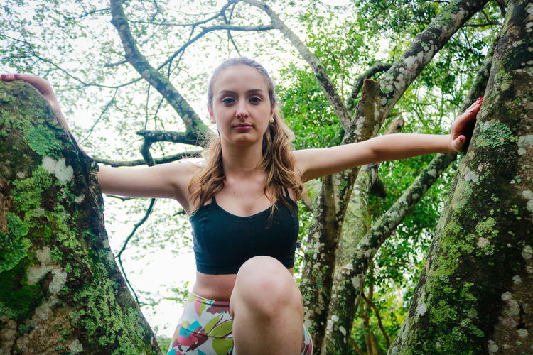 Adult Adults Only Beautiful Woman Beauty In Nature Branch Casual Clothing Day Front View Growth Happiness Leisure Activity Lifestyles Looking At Camera Nature One Person Outdoors Park - Man Made Space People Portrait Real People Smiling Tree Young Adult Young Women