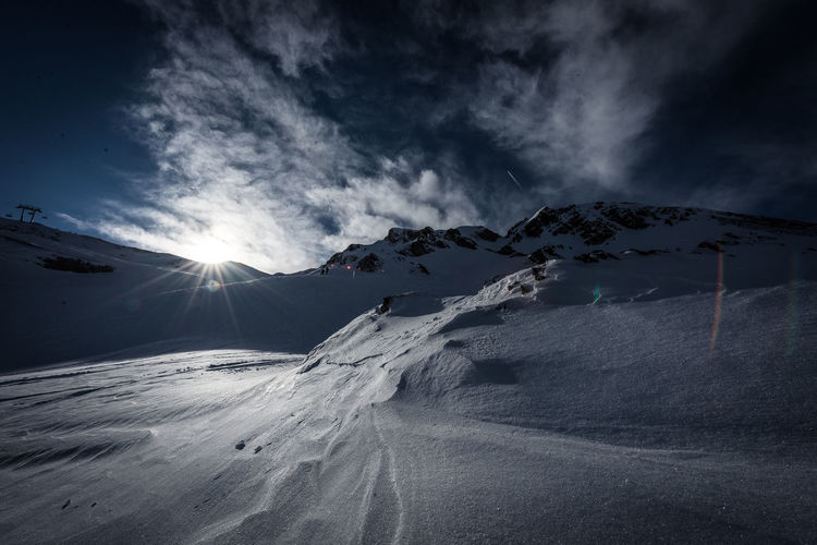 Snow Mountain Cold Temperature Winter Sky Beauty In Nature Scenics - Nature Cloud - Sky Environment Snowcapped Mountain Nature Tranquil Scene Landscape Tranquility Sun Sunlight Sunbeam Mountain Range Non-urban Scene Outdoors Lens Flare Bright