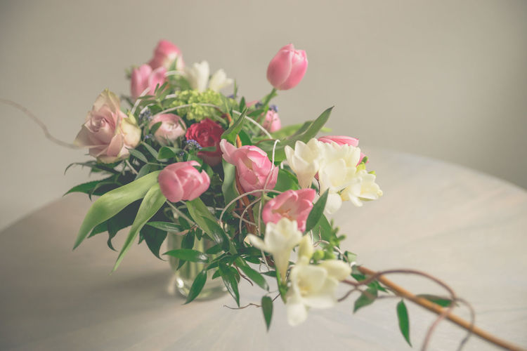 Beauty In Nature Bouquet Bunch Of Flowers Bunch Of Tulips Close-up Flower Flower Arrangement Flower Head Flowering Plant Fragility Freshness Indoors  Leaf Nature No People Petal Plant Plant Part Rosé Rose - Flower Spring Flowers Table Tulips Flowers Vase Vulnerability