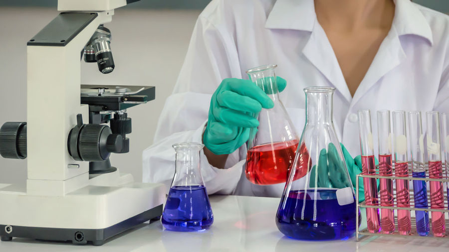 Midsection of scientist working in laboratory