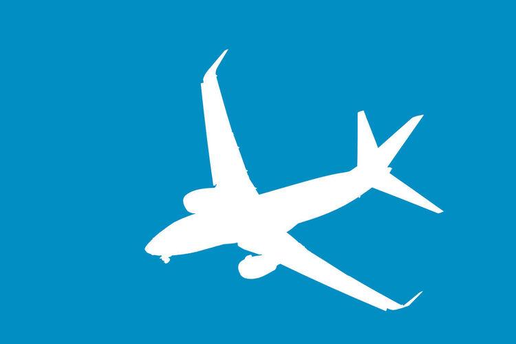 Airplane against clear blue sky