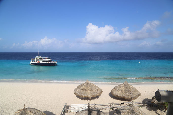 Beach Beauty In Nature Blue Boat Calm Caribbean Caribbean Sea Coastline Horizon Over Water Klein Curacao Mode Of Transport Nautical Vessel Sand Sea Seascape Shore Sky Tourism Tranquil Scene Tranquility Transportation Vacations Water
