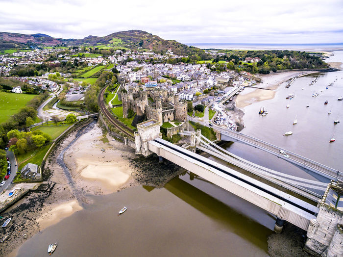 Aerial view of the historic town of Conwy with it's medieval castle - Wales - United Kingdom. Ancient Castle Conwy Conwy Castle Conwy Harbour Drone  Tourist Attraction  United Kingdom Wales Wales UK Welsh Aerial Aerial View Bridge English Fortress Heritage Historic Medieval North Travel Destinations Uk Village Wales❤