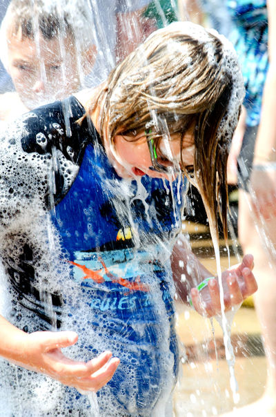 Aug 5 2017, Buchanan MI USA; kids of all ages play in messy wet bubbles on the streets of Buchanan MI during the Thrill on the Hill event Buchanan MI USA Children Fun Funny Kids Kids Being Kids Messy Summertime Active Bubble Childhood Close-up Day Editorial  Motion Outdoors People Playing Spraying Street Photography Summertime Fun Thrill On The Hill Water Wet