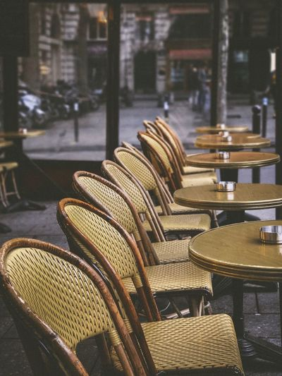 Wicker chairs and tables at outdoor restaurant