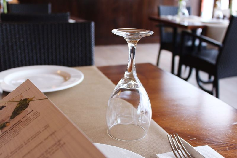 Close-up of wineglass on dining table at restaurant