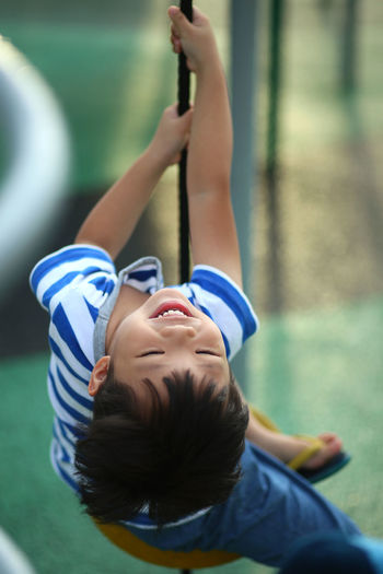 Kid having fun at the outdoor playground Fun Asian Boy Boys Child Childhood Day Emotion Focus On Foreground Fun Happiness Headshot Leisure Activity Lifestyles Outdoors People Playground Portrait Real People