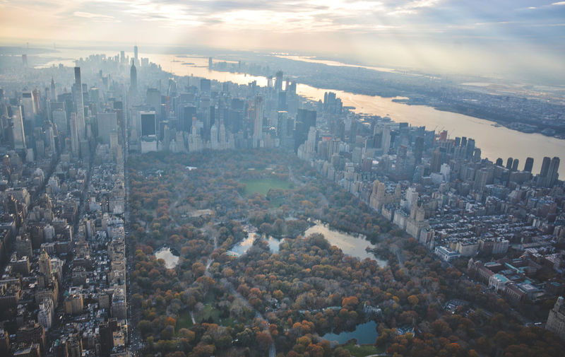 Flying above the city City Skyscraper Cityscape Aerial View Travel Destinations Outdoors Urban Skyline No People Cloud - Sky Architecture Sunset Landscape Sky Modern Day Fall Beauty New York NYC Photography NYC Central Park Flynyon Haze Weather