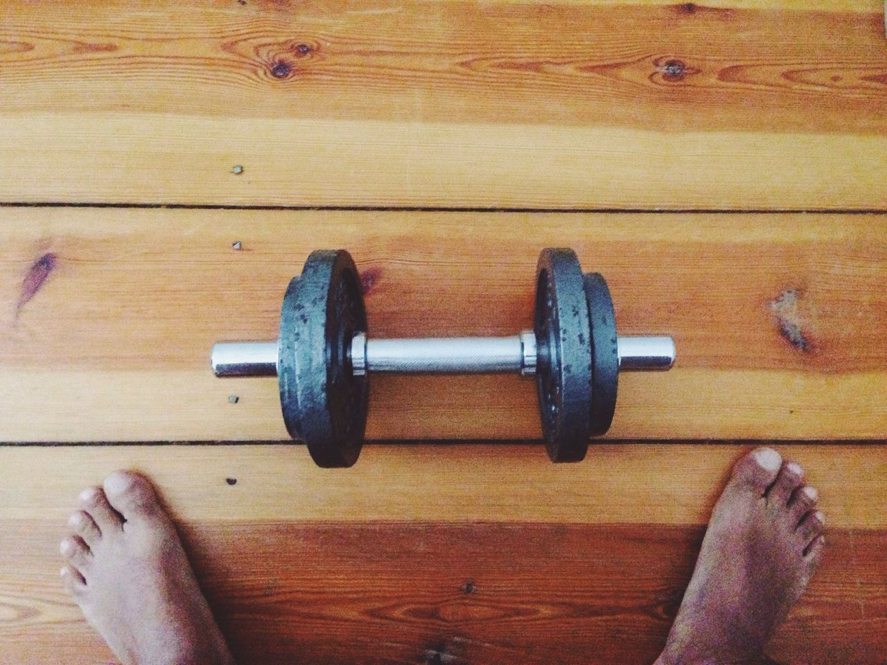 Man and dumbbell