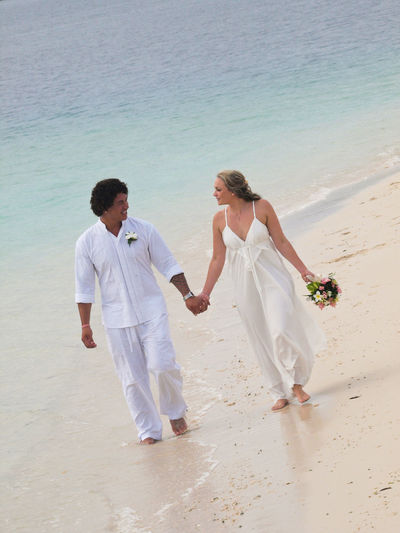 Beach Wedding Port Vila Vanuatu Beach Wedding Beauty In Nature Bonding Casual Clothing Cherry Blossoms Clear Water Couple Couple - Relationship Day Dream Friendship Full Length Lifestyles Love Love Married Couple Paradise Beach Perfect Day Scenics Togetherness Tranquility Vanuatu Vivid International Water Wedding