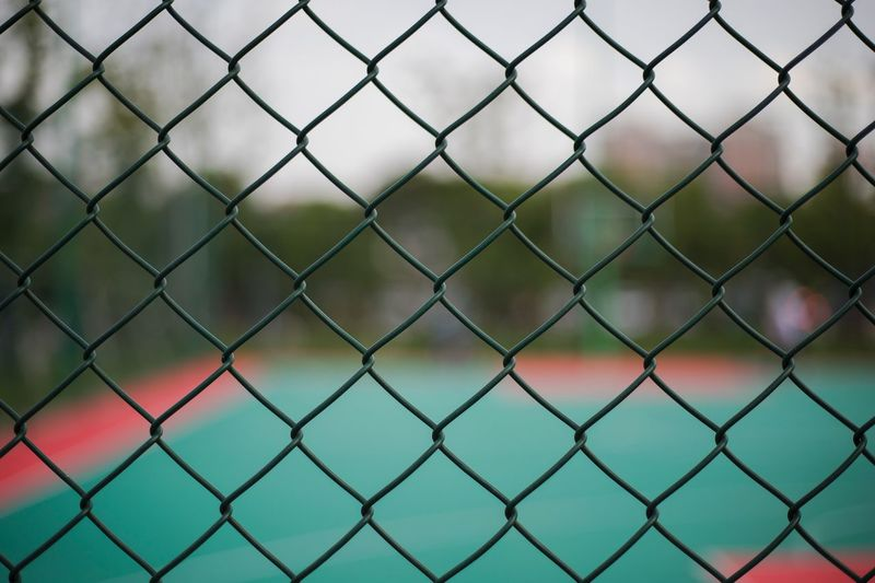 Full frame shot of fence at sports court