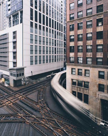 Train On Tracks Amidst Buildings