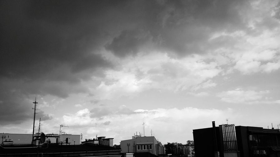 dramatic skies over Krakow Cloud - Sky City Building Exterior Sky No People Cityscape Krakow Krakow Poland Sky And Clouds Sky And City Black And White Dramatic Sky Drama Rooftops Antennas
