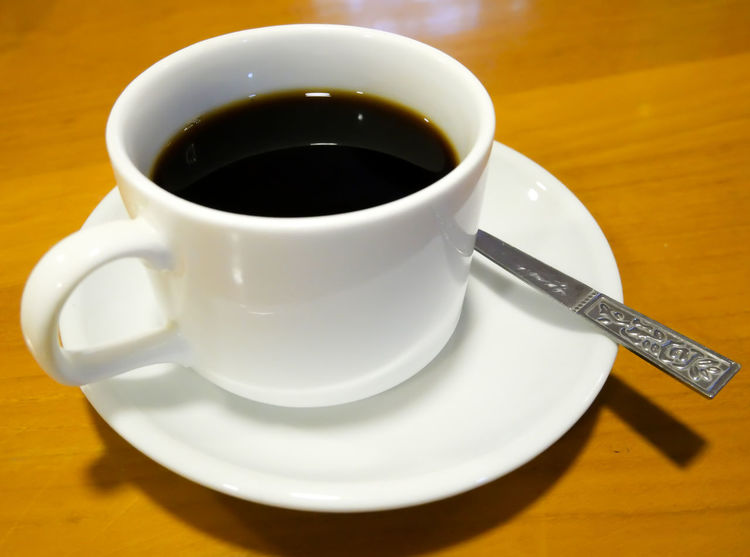 Black coffee in white glass placed on a wooden table. White Glasses Black Coffee Close-up Coffee - Drink Coffee Cup Cup Day Drink Food And Drink Freshness Indoors  No People Refreshment Saucer Table White Cap