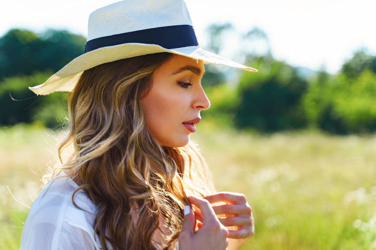 Portrait of beautiful woman in red hat