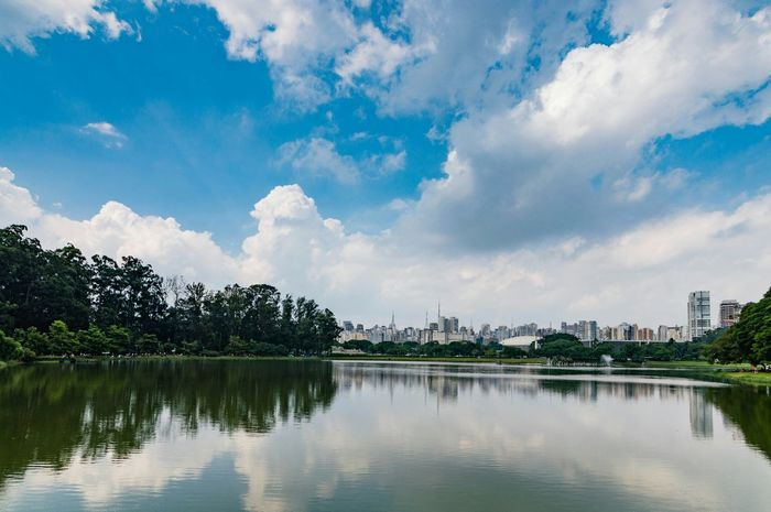 EyeEm Selects Reflection Lake Cloud - Sky Water Tree Sky Travel Destinations Tranquility Landscape Outdoors Day City Beauty In Nature No People Vacations Travel Nature Scenics