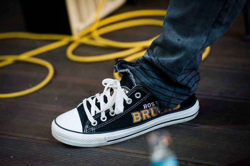 Boston Boston Bruins Converse Body Part Canvas Shoe Casual Clothing Flooring High Angle View Human Body Part Human Foot Human Leg Human Limb Jeans Lifestyles Limb Low Section One Person Real People Shoe Unrecognizable Person