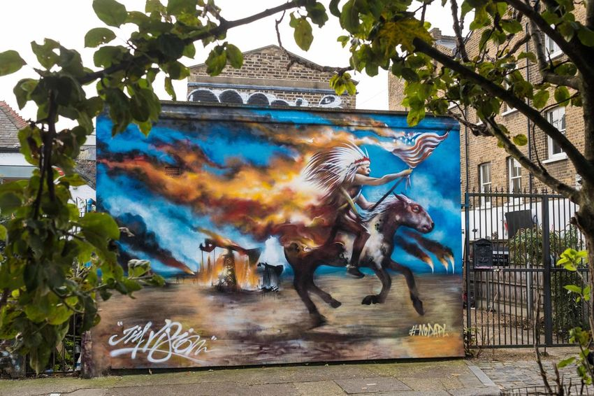 #NODAPL protest graffiti in Shoreditch, London Graffiti London Native American Indian USA Building Exterior Built Structure Day Full Length Motion Multi Colored Outdoors Streetart Tree Uk