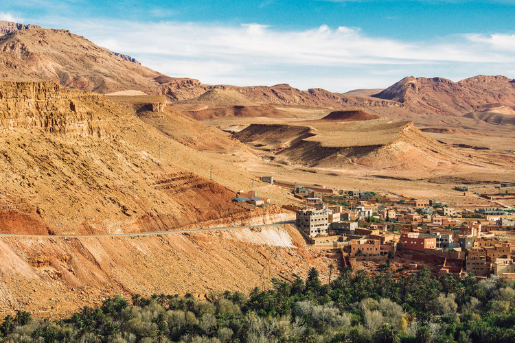 Panorama of canyon, palm trees and ancient berber village of tinghir in sahara desert , morocco