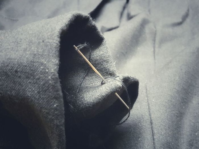 Close-Up Of Sewing Needle On Fabric