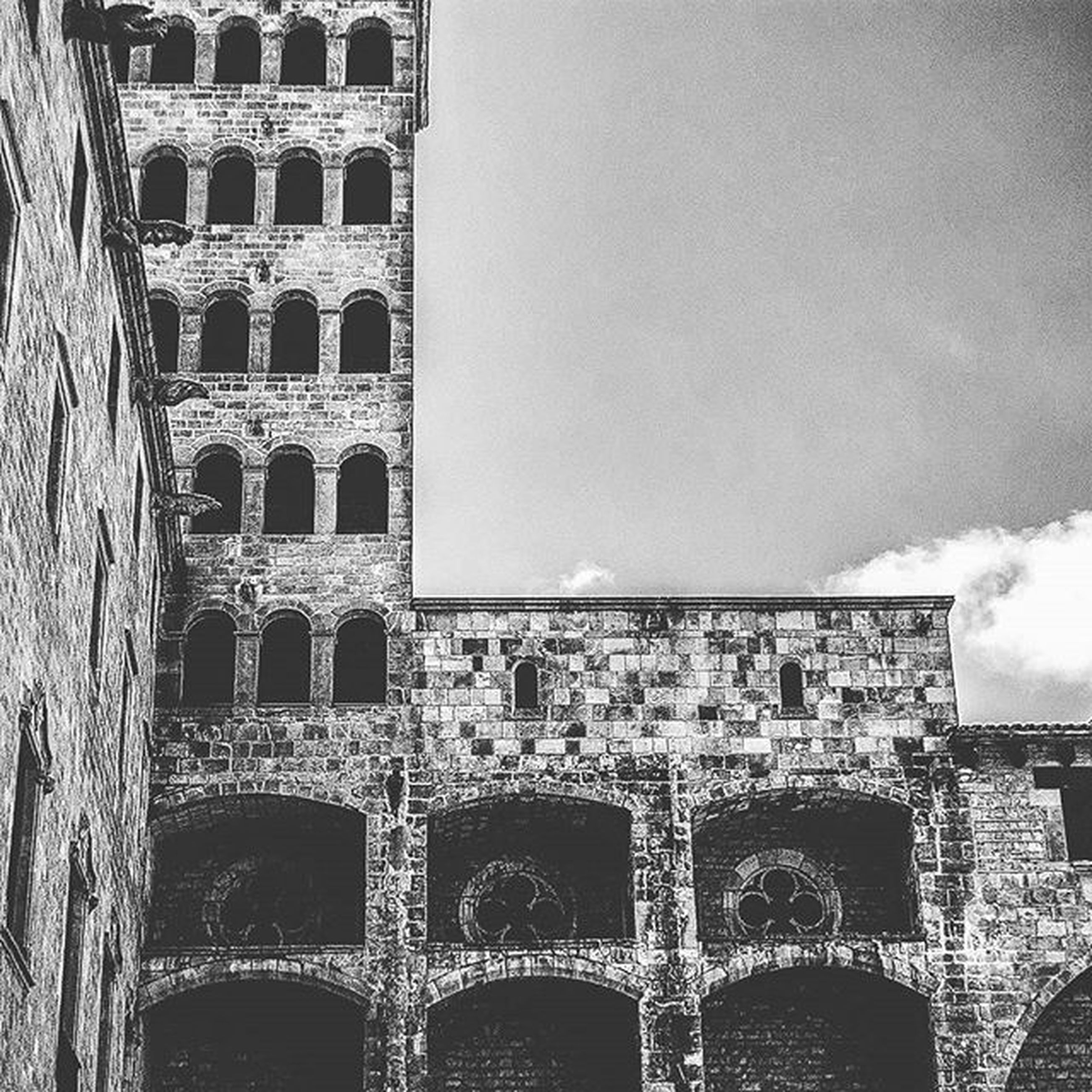 architecture, built structure, building exterior, city, cityscape, sky, window, building, history, day, pattern, tower, arch, outdoors, famous place, residential building, no people, modern, travel destinations