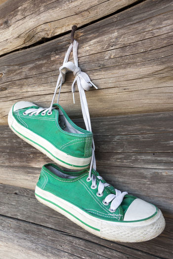 Canvas shoes hanging on wood