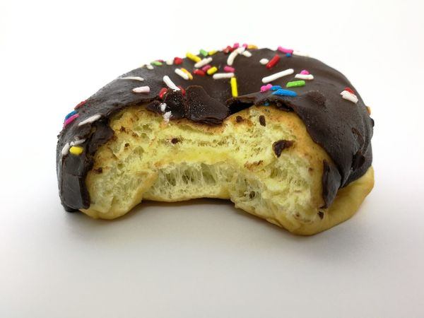 doughnut has been bitten Dounut Time!!! Dounuts Bitting Dounut White Background Food And Drink Food No People Sweet Food Multi Colored Close-up Freshness Day Food Stories
