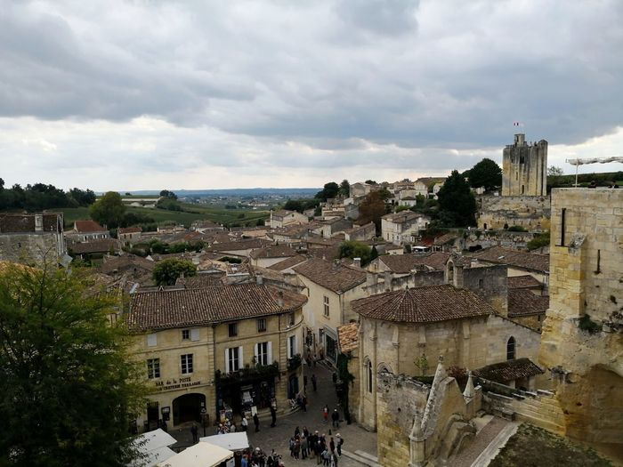 View of the village of Saint Emilion in France France Saint Emilion St Emilion St Emillion Cityscape City Community Residential Building Old Town High Angle View Town Tree Sky Architecture TOWNSCAPE Rooftop Tiled Roof  Human Settlement Townhouse Roof Tile Crowded Housing Development Fortified Wall Residential Structure Roof Aerial View Housing Settlement Residential District Row House Bell Tower