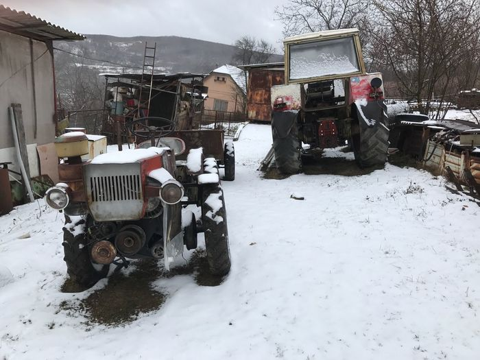 Starý Haj, NR. Krupina Slovakia Winter Wintertime Christmastime Tractor Snow Ice Farm Smallholding Dilapidated Outdoors Barn Vehicle Trees Moody