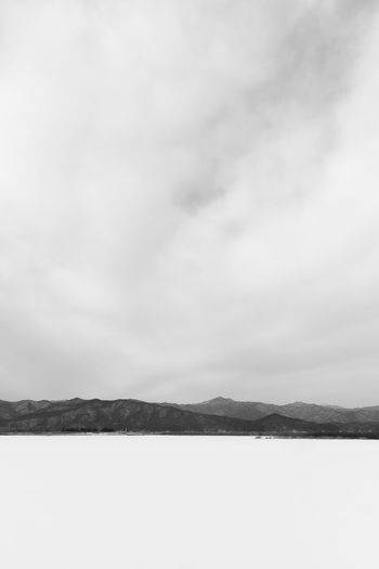 black and white image of snow-covered lake, Uiamho Lake in Chuncheon, Gangwondo, South Korea Black & White ChunCheon Cold Lake Cold Weather Gongjicheon Snow Land Uiamho Lake Winter Winter Landscape Beauty In Nature Black And White Blackandwhite Bw Cold Cold Temperature Day Landscape Mountain Nature No People Outdoors Scenics Sea Sky Snow-covered Snow-covered Lake Tranquil Scene Tranquility Water Winter Lake Winter Land Winter Time