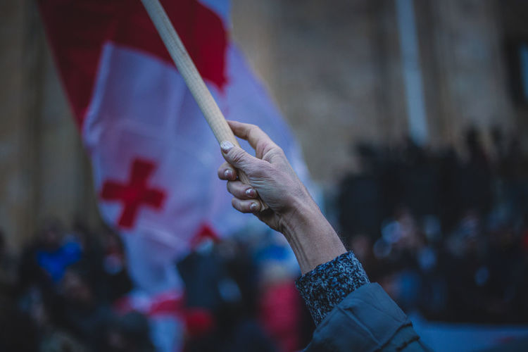 Close-up of hand holding flag