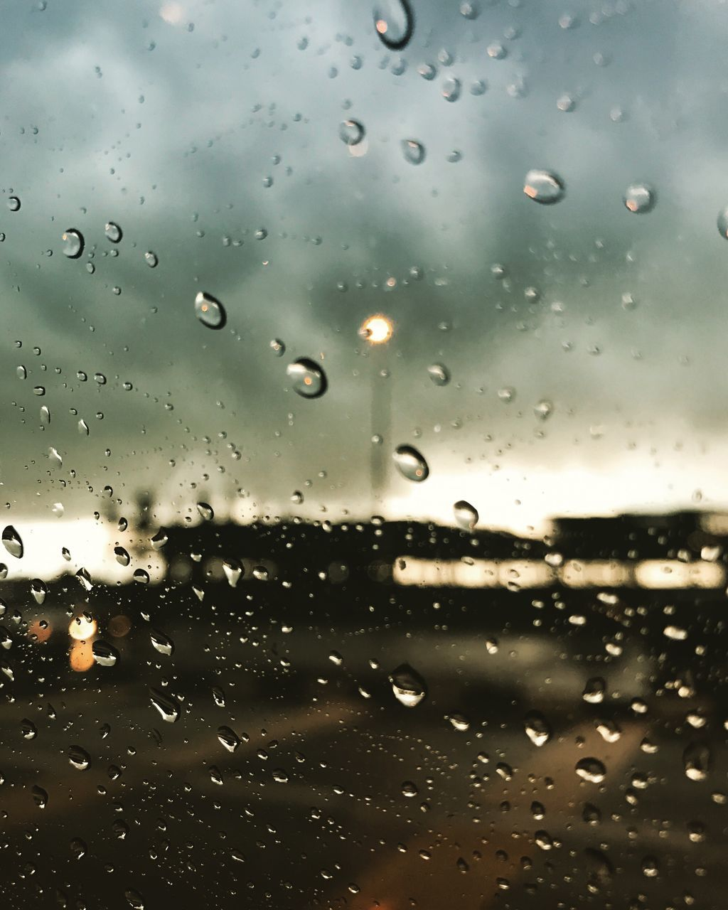 drop, window, glass - material, wet, rain, no people, water, raindrop, weather, indoors, close-up, focus on foreground, land vehicle, full frame, backgrounds, day, nature, sky, freshness
