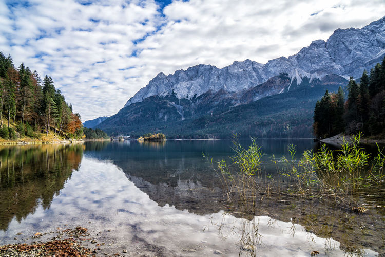 Eibsee in autumn Water Mountain Scenics - Nature Beauty In Nature Lake Tranquility Reflection Tranquil Scene Sky Mountain Range Cloud - Sky Nature Non-urban Scene Day Tree Plant No People Idyllic Waterfront Formation Mountain Peak Autumn Bavaria Alps