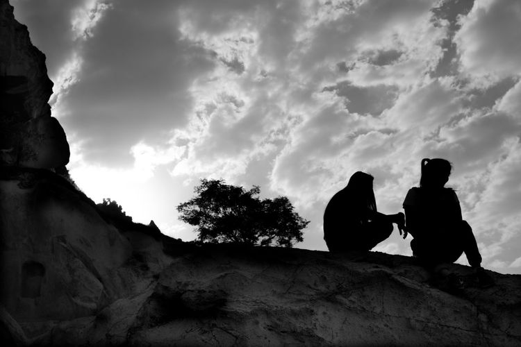 On the Rocks in Cappadochia Cloud - Sky Sky Real People Silhouette Two People Men Sitting Low Angle View Friendship Outdoors Day Togetherness Nature Adventure Tree Beauty In Nature People