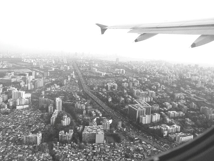 Monochrome Photography Cityscape City Flying Aircraft Wing Airplane Aerial View Sky Travel Crowded Mumbai Cityofdreams  From above all magnificence breaks down into Blacks and Whites!!