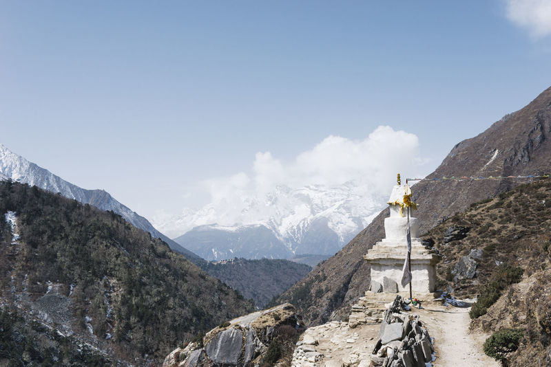 EBC Trek, Nepal Himalayas Path The Week on EyeEm Architecture Beauty In Nature Belief Day Environment Formation Landscape Leisure Activity Mountain Mountain Peak Mountain Range Nature Outdoors Place Of Worship Religion Rock Scenics - Nature Sky Solid Spirituality Tranquility Travel
