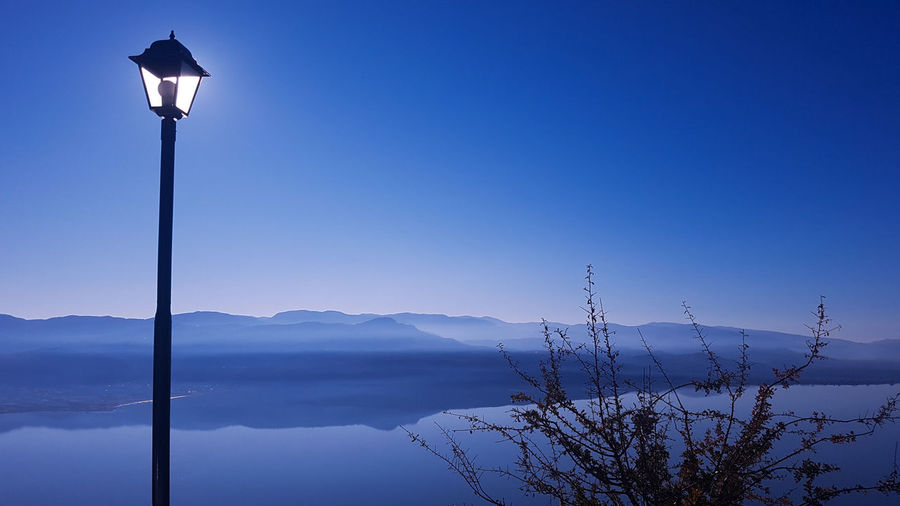 Scenic View Of Street Light Against Clear Blue Sky