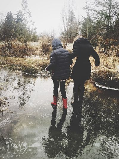 People Real People Adult Happiness Outdoors Bonding Warm Clothing Nature Day Ice Two People Fun Winter Togetherness Water Full Length Girl Beautiful Woman Two Women Rear View Walking Tree Sky Child Fresh On Eyeem
