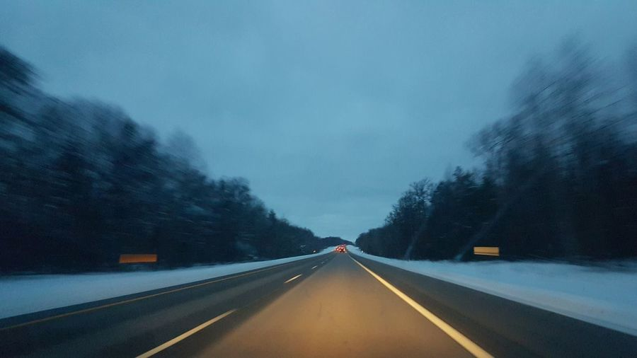 The Way Forward Road Highway Transportation Landscape Outdoors Winter Winter Driving Safe Driving Travel Snow Plowed Road Straight Road Blurred Motion Passenger Perspective Distance Evergreen Trees Dusk Evening Headlights Car Travel Michigan Northern Michigan Winter In Michigan Cold Temperature