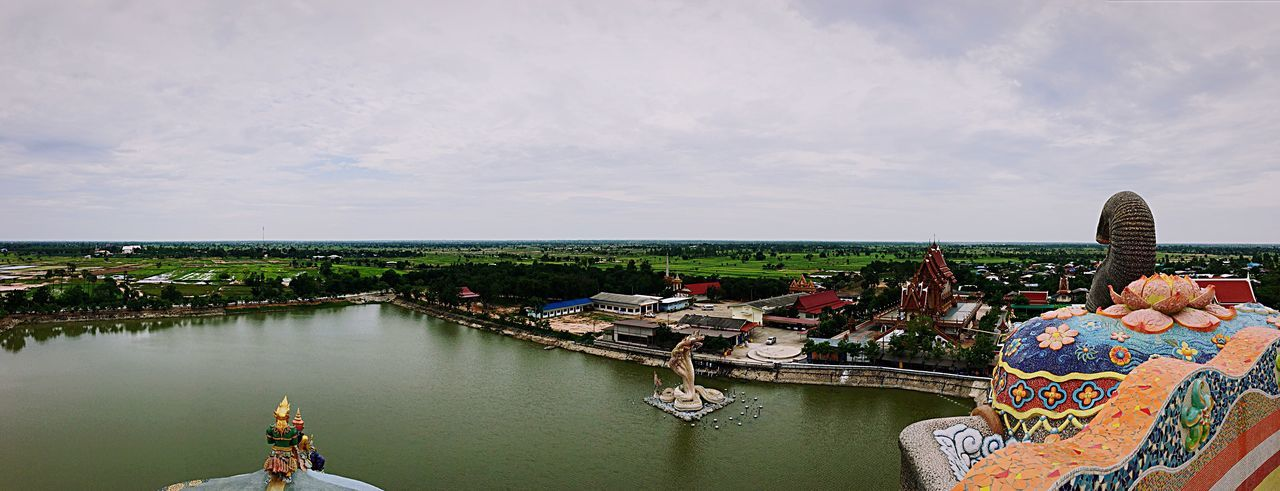 High angle view of wat ban rai by river against cloudy sky