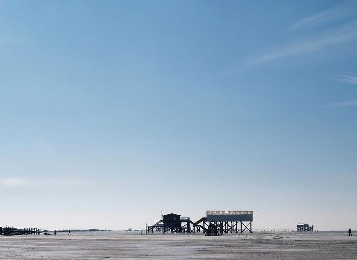 Sankt Peter Ording beach, snow in february Sky Nature Pets Day Built Structure Vertebrate Architecture Blue Copy Space No People Land Outdoors Herbivorous Beach Building Exterior