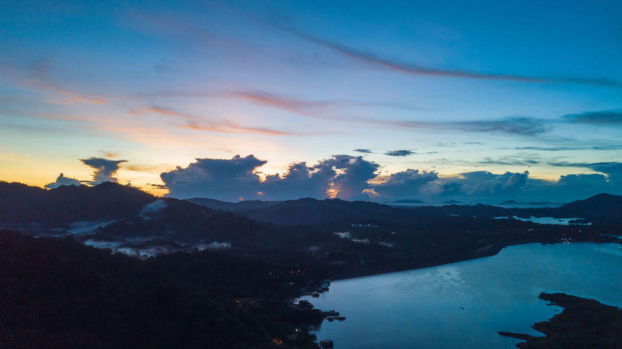 Aerial view of kenyir lake during blue hour sunrise.
