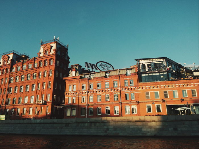 Architecture Building Exterior Outdoors Built Structure Day City Low Angle View Sky No People Water Cityscape Redoctober Red October Krasny Oktyabr Factory Moscow Moscow, Москва Moscow, Russia Moscow River Moscow ♥️ Красный Октярбь The Street Photographer - 2017 EyeEm Awards The Architect - 2017 EyeEm Awards Colour Your Horizn