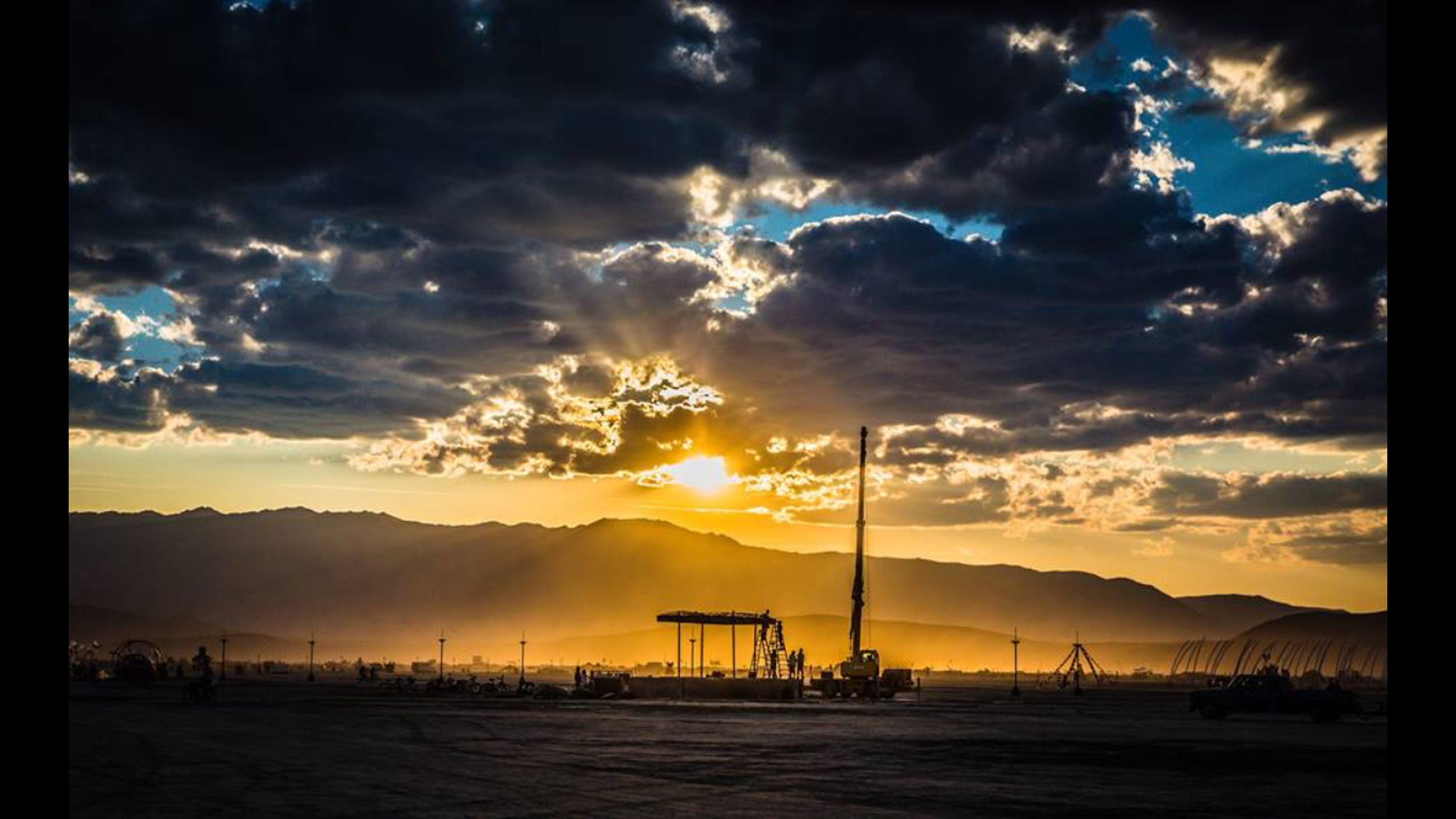 sunset, sky, mountain, scenics, sun, tranquil scene, beauty in nature, tranquility, cloud - sky, mountain range, silhouette, nature, idyllic, sunlight, cloud, landscape, orange color, sunbeam, dramatic sky, cloudy