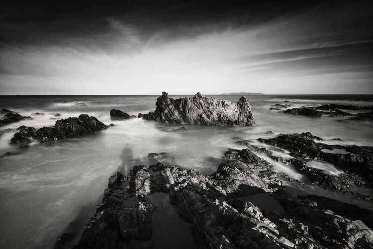 Beautiful long exposure shot of seascape in black and white.Nature composition. Terengganu, Malaysia Art Beach Beauty In Nature Breaking Cloud - Sky Horizon Horizon Over Water Land Long Exposure Motion Nature Nature Background No People Outdoors Power In Nature Rock Rock - Object Rock Formation Scenics - Nature Sea Sky Solid Water Wave